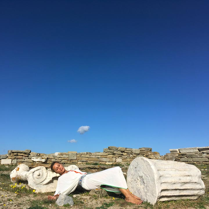 Apostolia Papadamaki practicing day dreaming amongst the ancient ruins on sacred Delos island greece